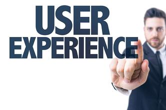 Business man pointing the text User Experience